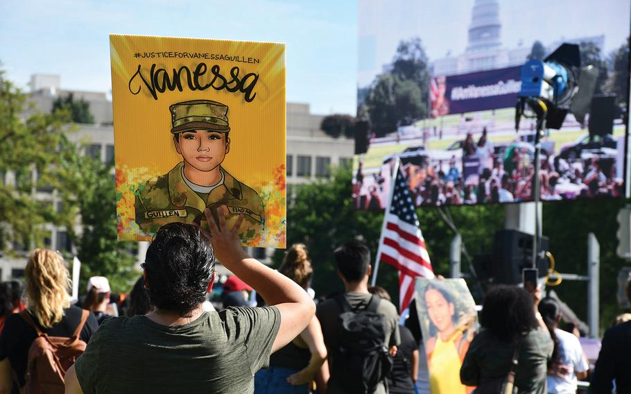 Activists held signs depicting Spc. Vanessa Guillen at a rally Thursday, July 30, 2020, in Washington, D.C. Guillen's family said Vanessa, who was murdered at Fort Hood in April, told them she was being sexually harassed but was too afraid to report it.