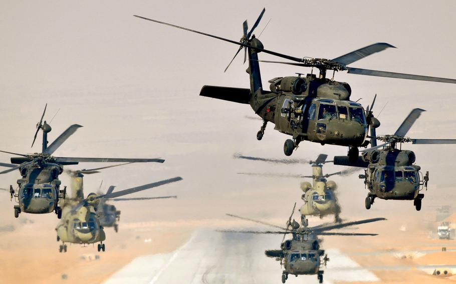 Six UH-60L Black Hawks and two CH-47F Chinooks launch a mission from Multinational Base Tarin Kowt, Afghanistan, in Jan. 2013. Beginning in October, soldiers selecting a career in aviation will be required to serve at least 10 years after graduating from flight training.