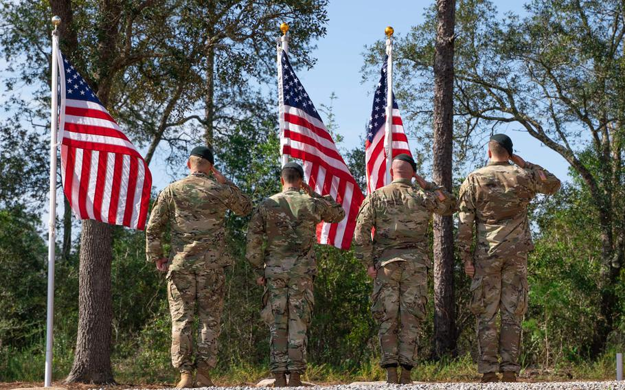 Members of 7th Special Forces Group (Airborne) salute during a memorial and awards ceremony on Friday, Aug. 21, 2020, at the group's compound on Eglin Air Force Base, Fla., where three stones were inscribed with the names of Green Berets from the unit's 1st Battalion who were killed in Afghanistan in 2019.