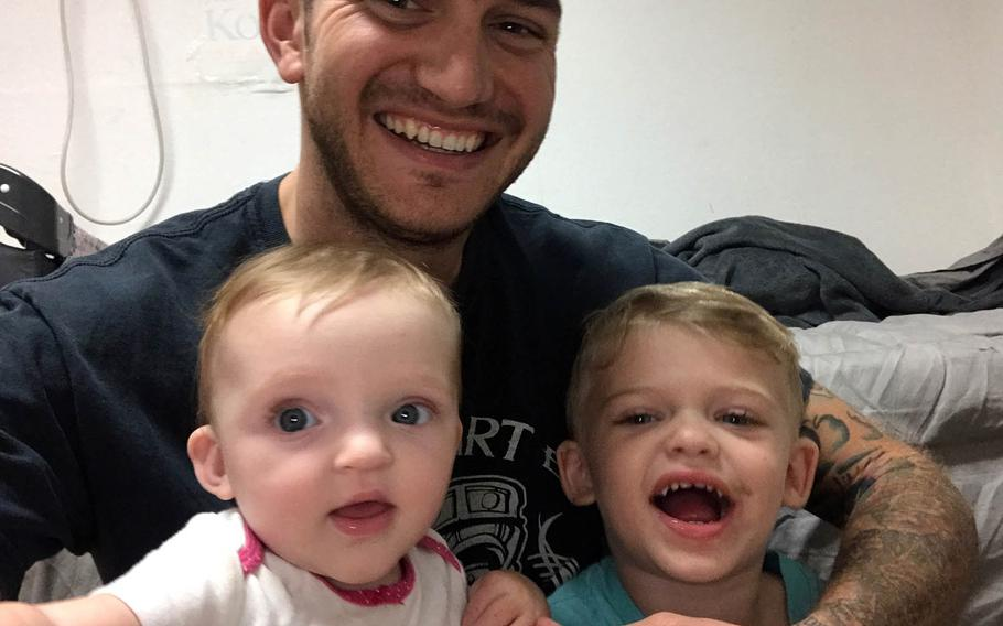 James Lobisch poses with daughter Abigail and son Zachariah.