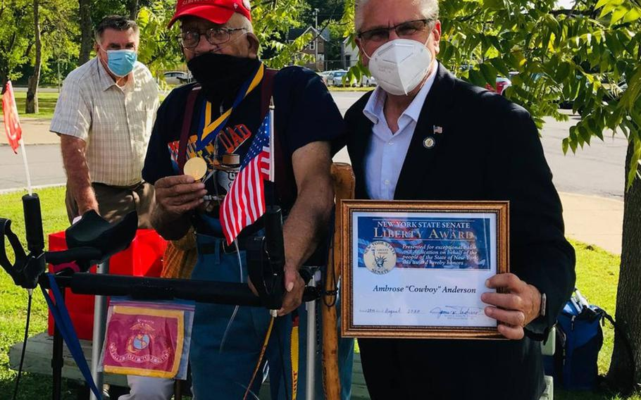 Ambrose ''Cowboy'' Anderson, 95, left, of Gloversville, N.Y., receives the New York State Liberty Medal from state Sen. Jim Tedisco, Aug. 28, 2020. Anderson was one of the Montford Point Marines who endured discrimination while serving during World War II, including at the Battle of Iwo Jima.