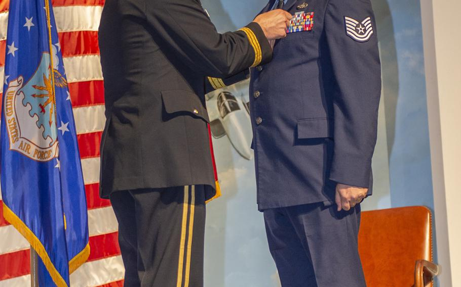 Air Force Tech. Sgt. Franklin Wetmore, of the 202nd Engineering Installation Squadron, 116th Air Control Wing, Georgia Air National Guard, was awarded the Purple Heart by Maj. Gen. Thomas Carden, Adjutant General of the Georgia Department of Defense, during a ceremony at the Museum of Aviation, Warner Robins, Ga., on Sept. 13, 2020. Wetmore earned the medal for service and wounds received during a Taliban attack on Bagram Airfield in December.