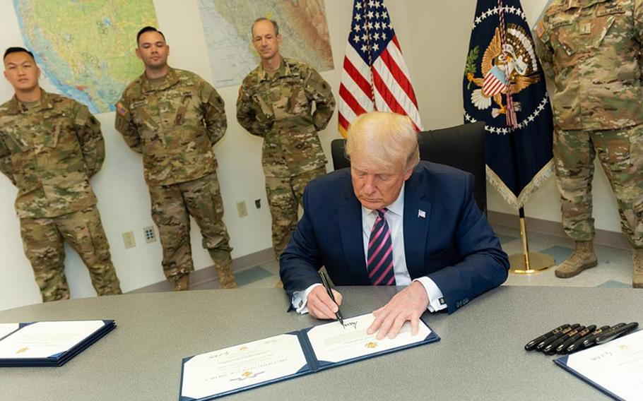President Donald Trump honored seven members of the California National Guard with the Distinguished Flying Cross at a hangar in McClellan Park, Calif., on Sept. 14, 2020.