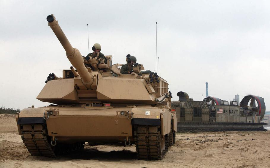 An M1A1 Abrams tank of Company C, 4th Tank Battalion, 4th Marine Division, leaves a Navy Landing Craft Air Cushion ship during an exercise in South Korea in 2014. The unit was deactivated in August and more than three dozen former unit members enlisted in the Idaho Army National Guard on Sept. 13, 2020.