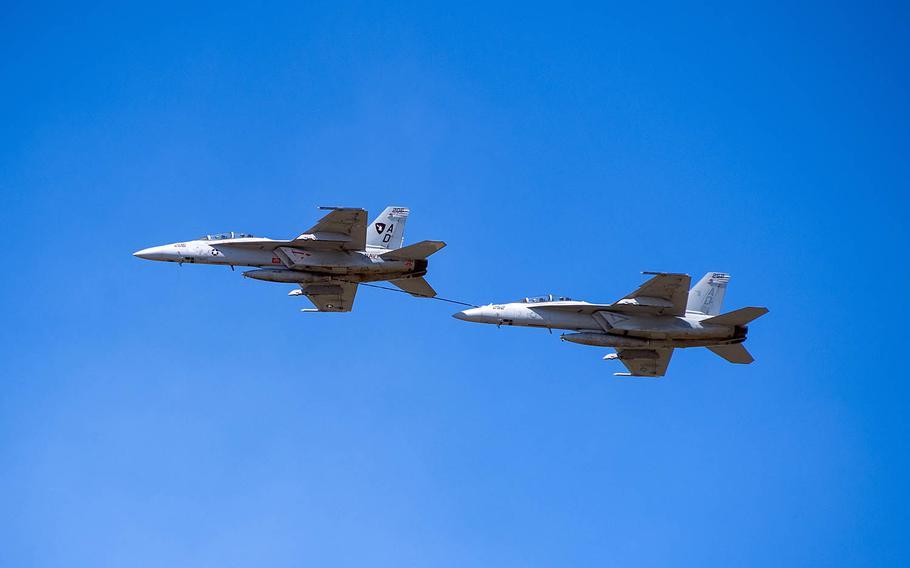 Two F/A-18 Super Hornet refuel during an air show at Naval Air Station Oceana, Va., Sept. 21, 2019.