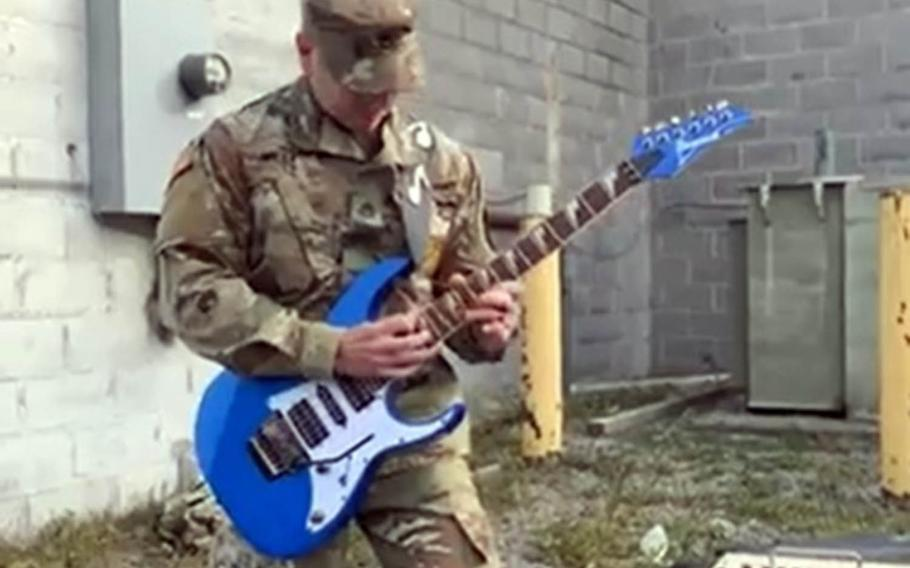 Staff Sgt. Austin West, an Army musician and recruiter in Watertown, N.Y., honors Eddie Van Halen by performing a medley of his group's hits in this screenshot from a Facebook Live broadcast, Wednesday, Oct. 7, 2020.
