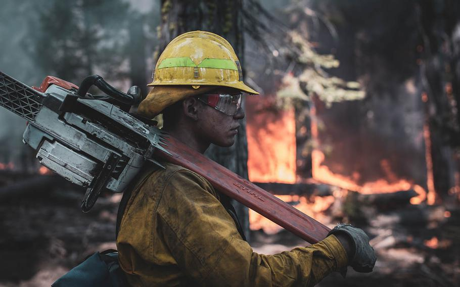 A Marine assigned to the 7th Engineer Support Battalion holds a fire line while conducting wildland fire fighting operations with National Interagency Fire Center personnel near the Sierra National Forest, Calif., Sep. 24, 2020.