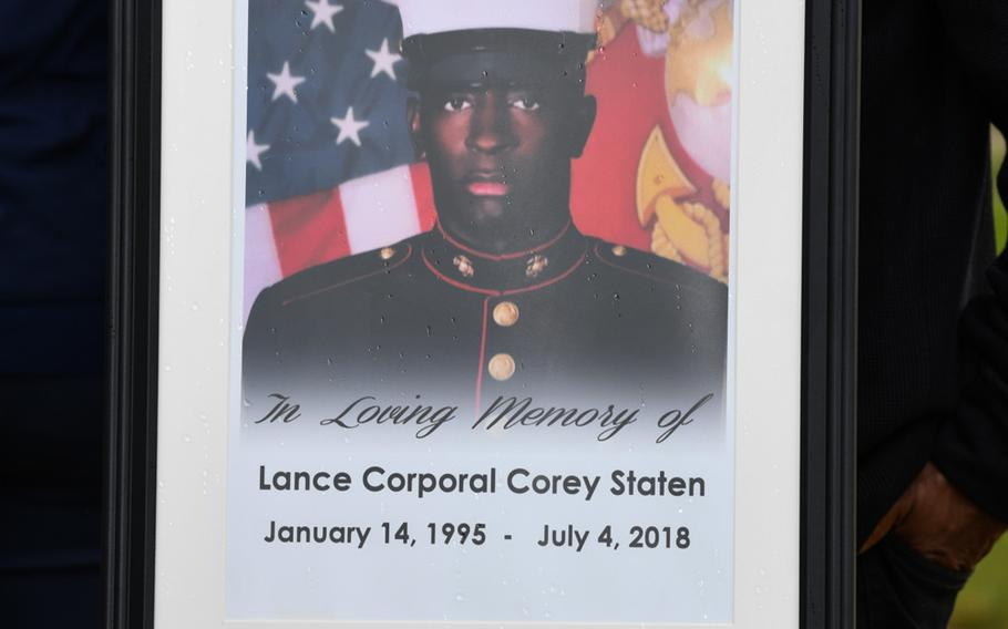 A photo of Lance Cpl. Corey Staten is displayed during an award ceremony held by 4th Combat Engineering Battalion in Baltimore, Md., Oct. 24, 2020. Lance Cpl. Staten was posthumously awarded the Navy Marine Corps Medal for sacrificing his life to save a fellow Marine's life.