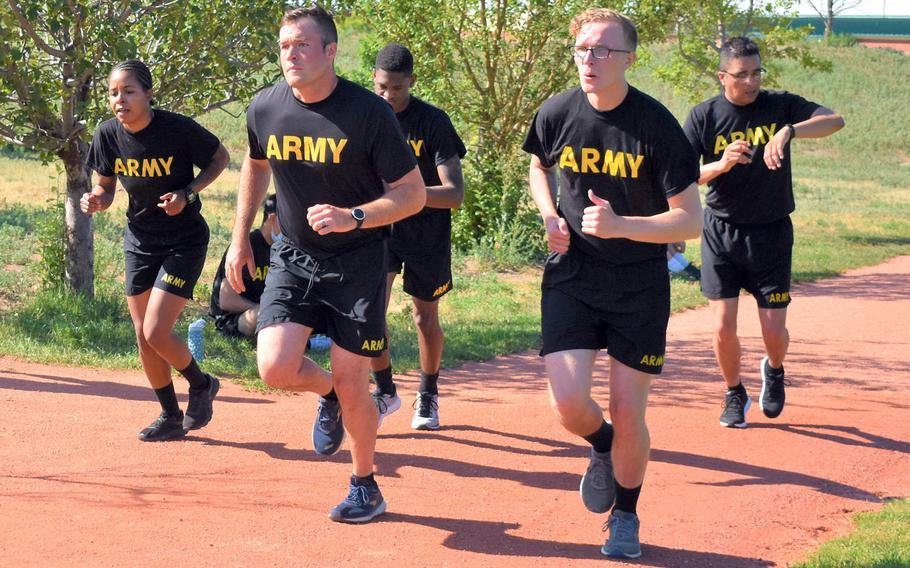 Soldiers with the 4th Infantry Division begin a two-mile run at Fort Carson, Colo., in June 2020. Service members and other patrons may now wear fitness gear to commissaries and military exchanges on Defense Department installations, Defense Secretary Mark Esper said in a memo dated Nov. 2, 2020.