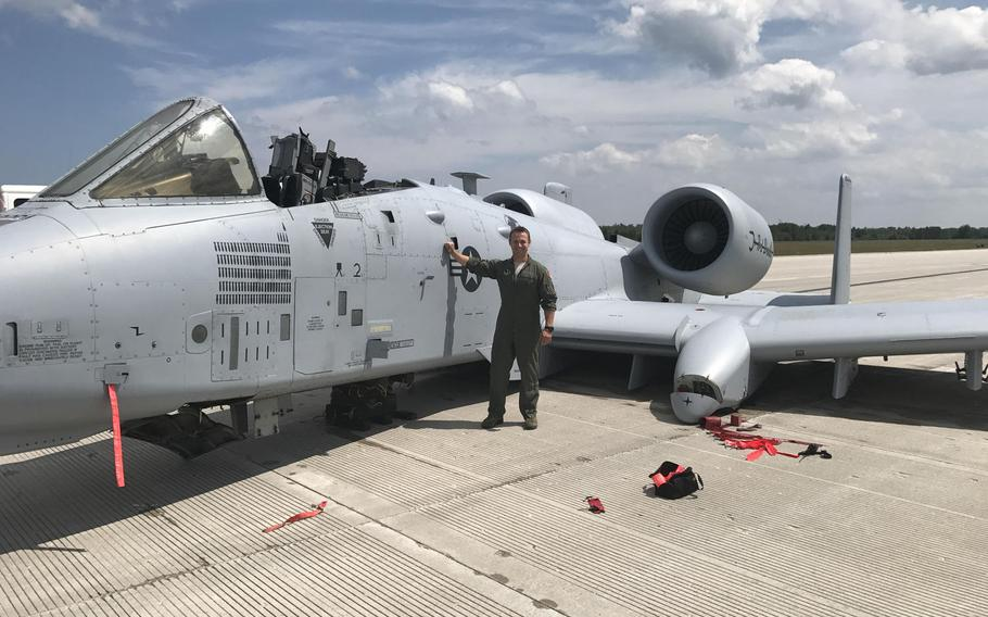 Capt. Brett DeVries, an A-10 Thunderbolt II pilot with the 107th Fighter Squadron, Selfridge Air National Guard base, Mich., poses next to the aircraft he safely landed after damage forced him to make an emergency landing July 20, 2017. He was awarded the Distinguished Flying Cross on Friday for his actions.