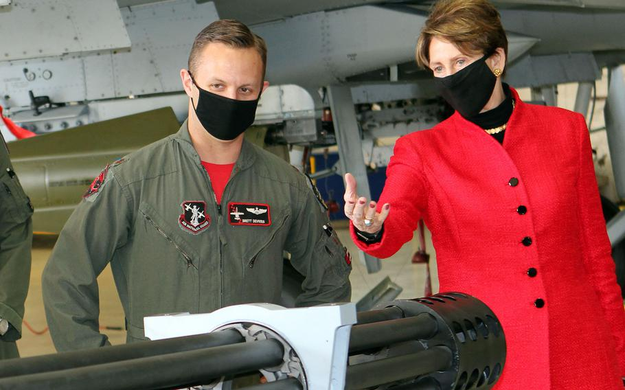 Maj. Brett DeVries briefs Air Force Secretary Barbara Barrett on the main weapon system used on an A-10 Thunderbolt II aircraft. The secretary visited Selfridge to award DeVries the Distinguished Flying Cross for superior aerial achievement, after he landed an A-10 with damaged landing gear and a missing canopy during a 2017 training flight over northern Michigan.