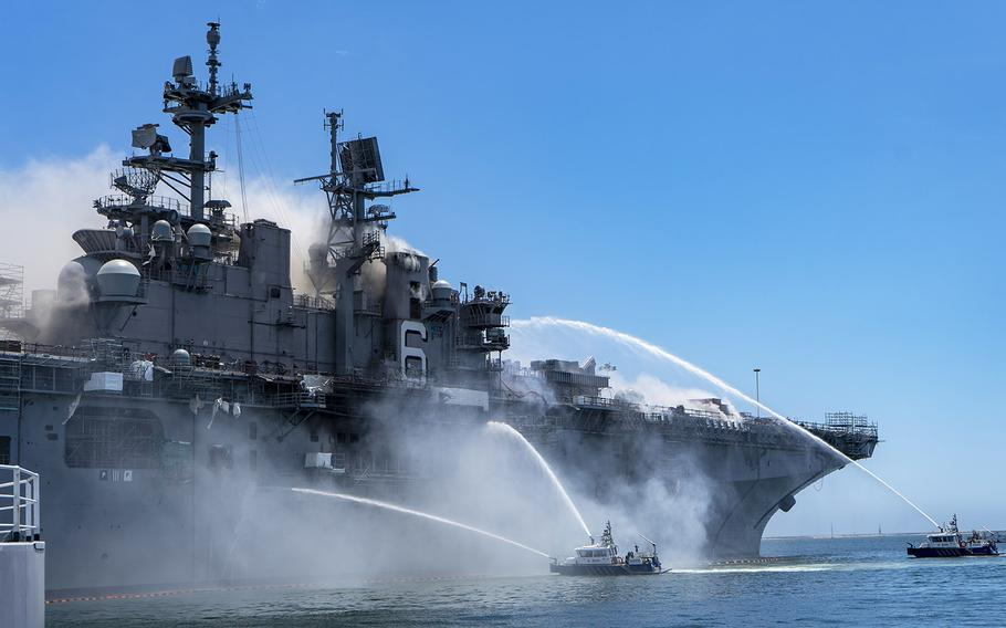 Port of San Diego Harbor Police Department boats combat a fire on board USS Bonhomme Richard at Naval Base San Diego, July 12, 2020.