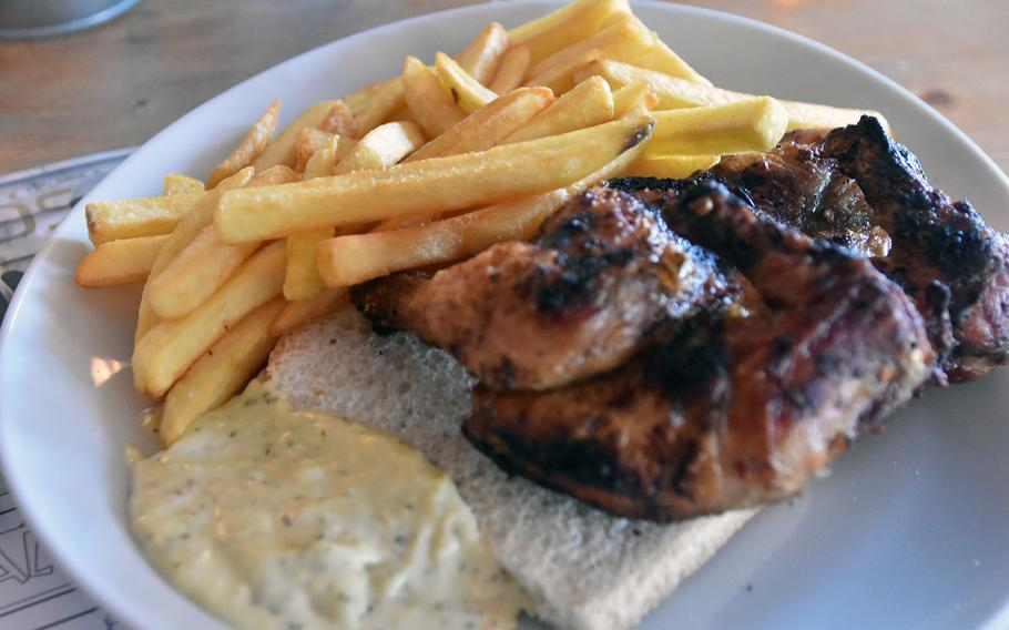The signature dish at Funky Go, a restaurant along the SS-13 outside Sacile, is barbecued chicken. It's offered with French fries or fried vegetables, a slice of toast and sauce.