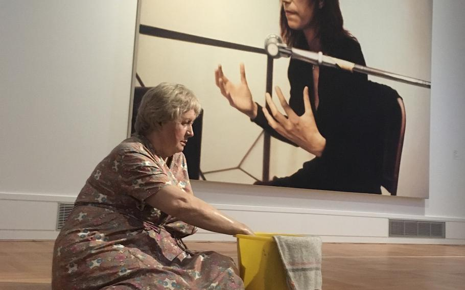 Stuttgart's Staatsgallerie has a large permanent exhibition that spans numerous genres. Its collection includes not only major artists such as Picasso and Matisse but  also lesser-known and offbeat works, such as a lifelike sculpture of a cleaning lady with a photo of rock star Patti Smith in the background.