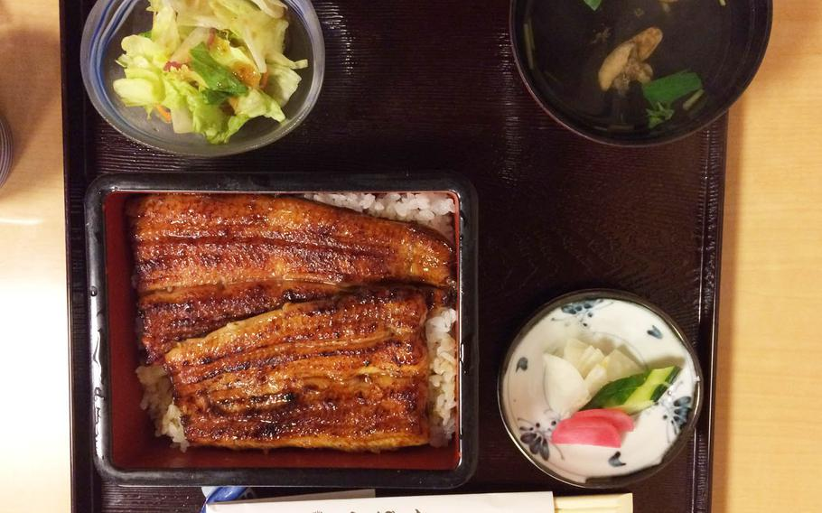 Time and effort goes into the unaju, which is charcoal-grilled eel dipped in a sweetened soy-based sauce over white rice, served at Kubota in western Tokyo.