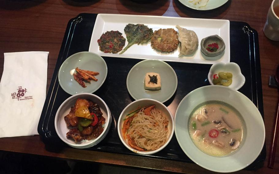 Korean pancakes and cold noodles with a spicy shiitake mushroom and pear sauce are among several courses served as part of a set menu at Balwoo Gongyang in Seoul.