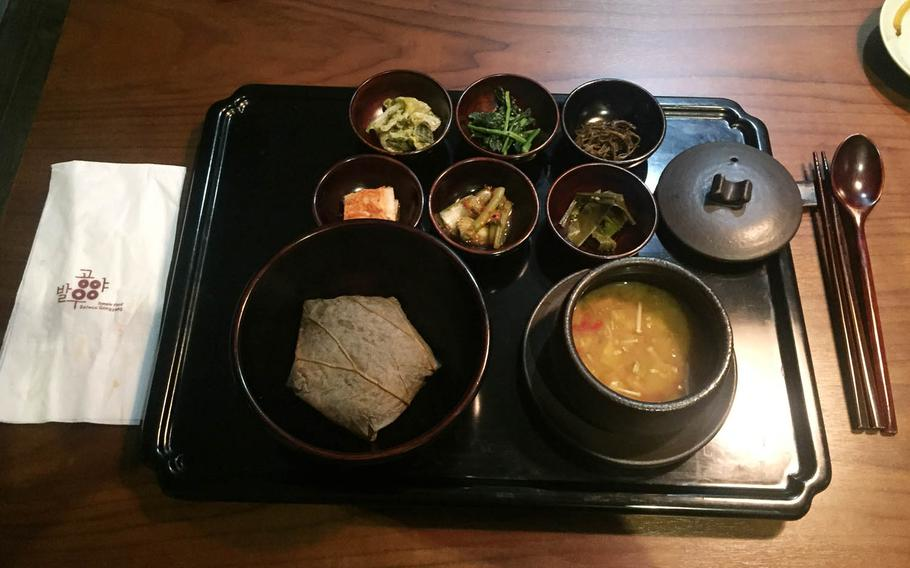 Sticky rice wrapped in a lotus leaf and spicy soybean paste stew are the highlights in the main course as part of a set menu at Balwoo Gongyang, a Michelin-starred restaurant serving traditional Korean Buddhist temple food in Seoul.