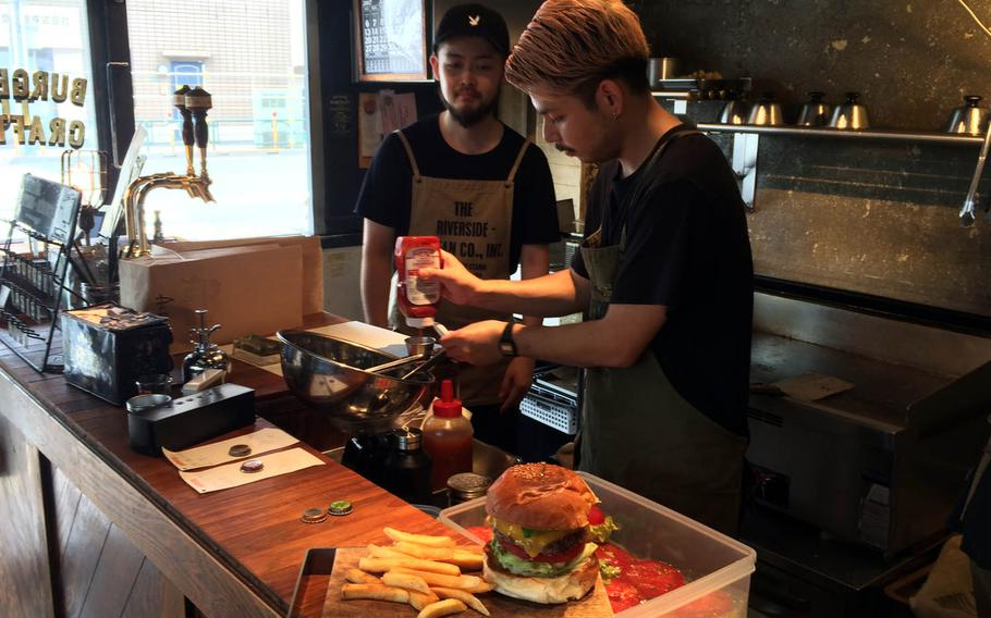 The burgers are stacked high at McLean Old Burger Stand in central Tokyo.