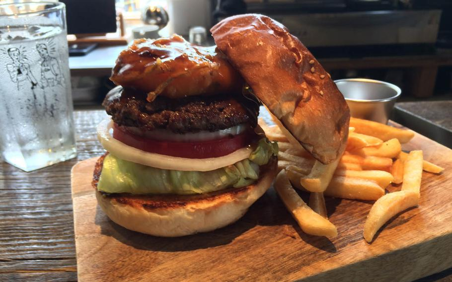 The McLean Tempura Burger from McLean Old Burger Stand in Tokyo was perfectly presented on a wooden cutting board that doubled as a plate. However, the flavors didn't mesh well.