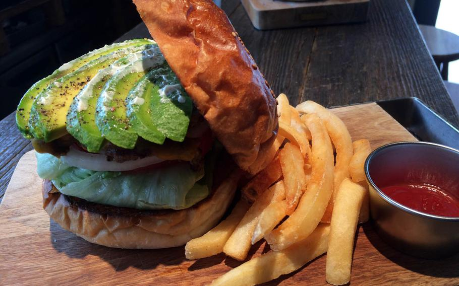 The Avocado Cheese Burger from McLean Old Burger Stand includes a big hunk of juicy, grilled meat and generous portions of avocado stacked between two delicious caramelized buns.