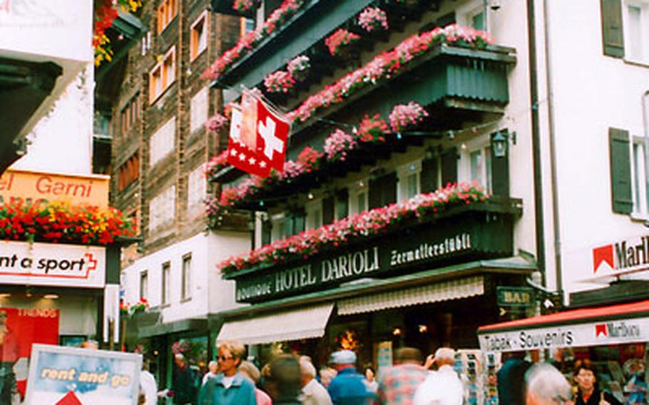 Zermatt's Bahnhof Strasse is a busy place lined with shops, hotels and restaurants.