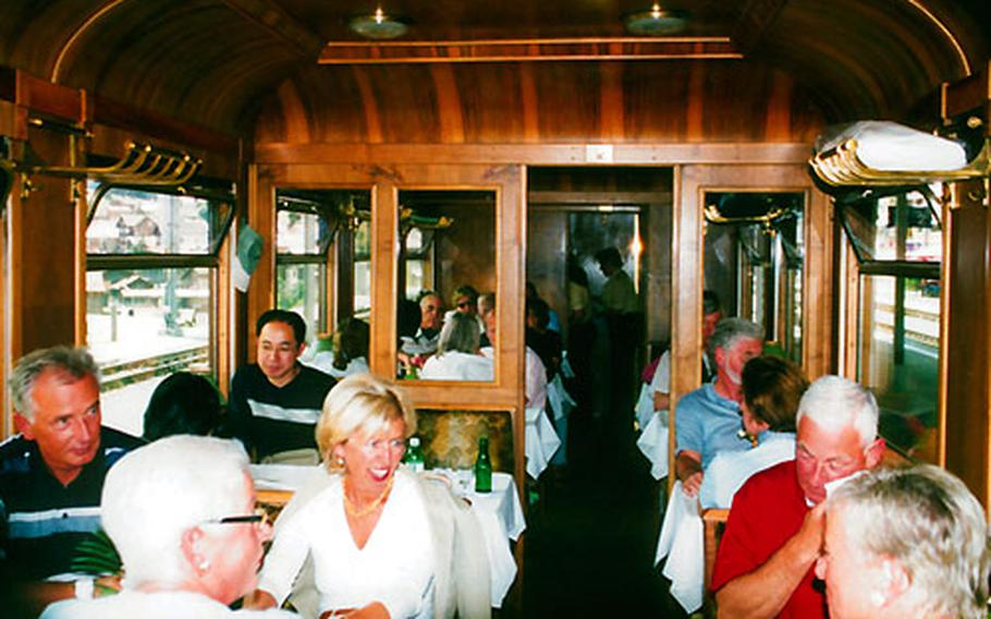 Dining in the Belle Époque dining car on the Glacier Express is an experience in old-world elegance.