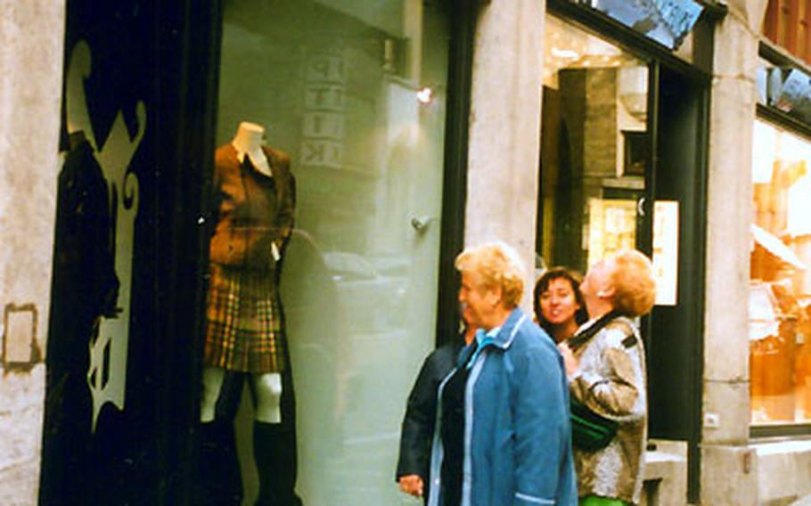 Visitors window shop in St. Moritz, Switzerland, which boasts sophisticated designer boutiques. This mountain retreat attracts the rich and famous as well as those who want to rub elbows with them.