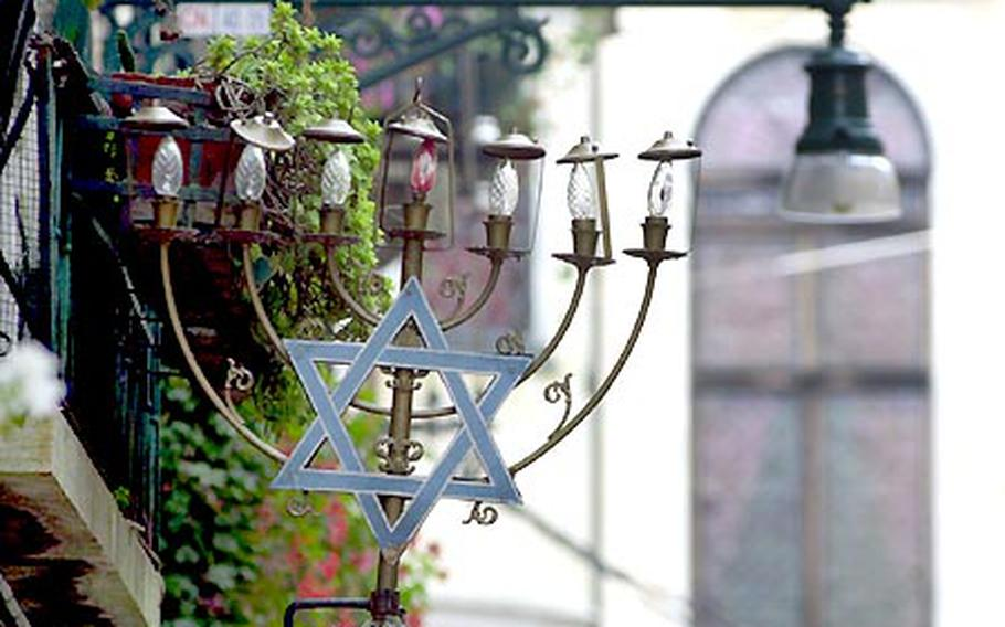 """Today the former """"Jewish ghetto"""" in Venice, Italy, is a lively but slightly rundown area of the city with peeling paint and drying clothes hanging from windows. Life now, as then, is centered on the Campo di Ghetto Nuovo, a large square lined with shops and kosher eateries."""
