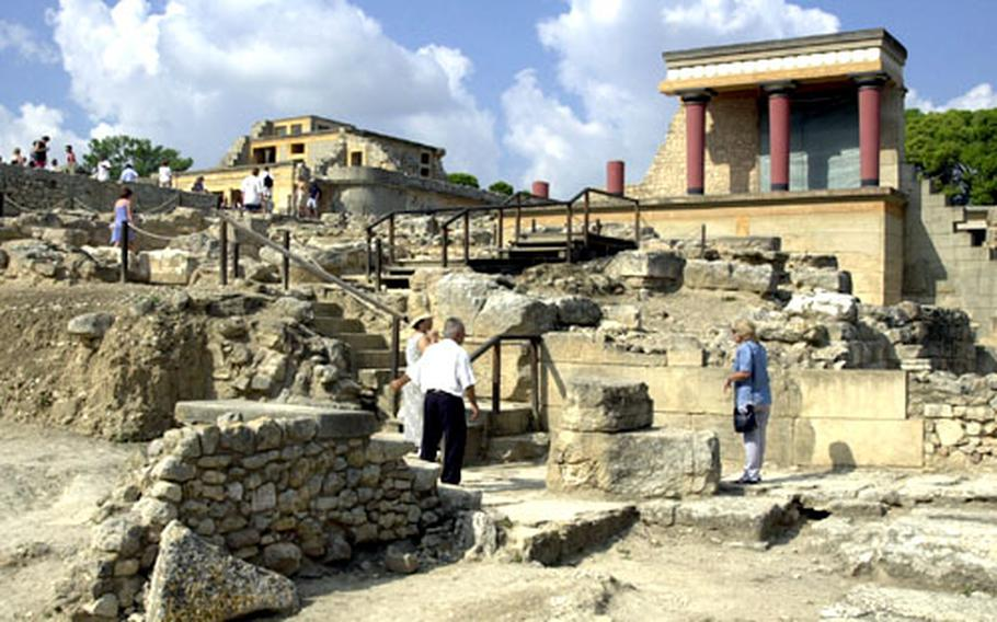 Tourists walk through the ancient ruins of the Minoan palace at Knossos. The Knossos ruins offer glimpses of Europe's fierce genesis.
