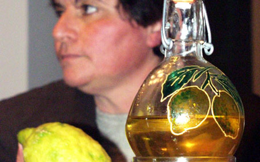 You can buy bottles throughout Italy for storing limoncello. Or, you can get creative and design your own, like this hand-painted one.