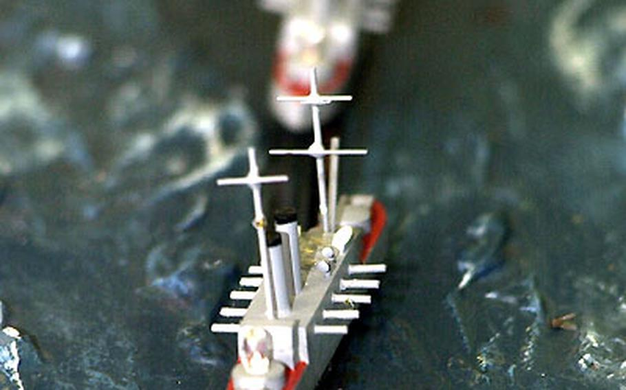 """A moving scale model aboard the Mikasa illustrates Admiral Togo's famous """"turn"""" during the May 1905 Battle of Tsushima in the Sea of Japan."""