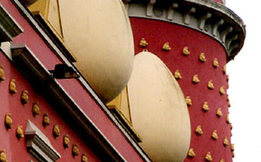 At the Dali Teatre Museu in Figueres, giant eggs top a pink wall.