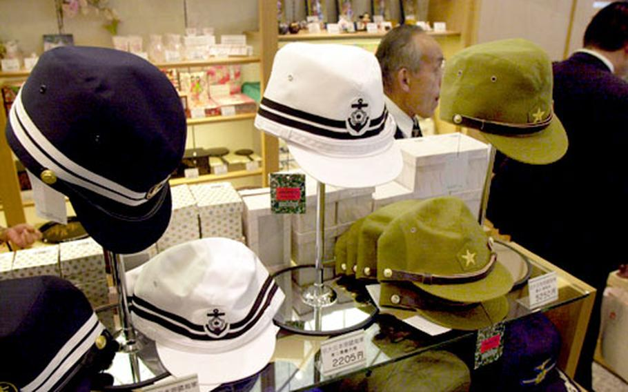 Japanese Imperial military hats are sold at the Yasukuni Shrine museum gift shop.