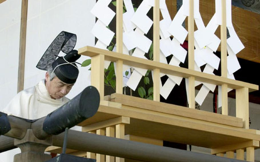 A Shinto priest bows during a ceremony at at the Yasukuni Shrine.