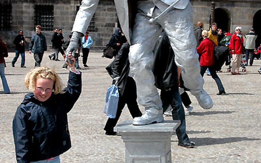 A mime entertains tourists in Amsterdam.