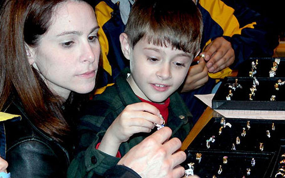 Amy Kieser and her son, Quentin, look at rings at the Stoeltie Diamonds store in Amsterdam. They are the family of Maj. David Kieser, a dentist at Ramstein Air Base, Germany.