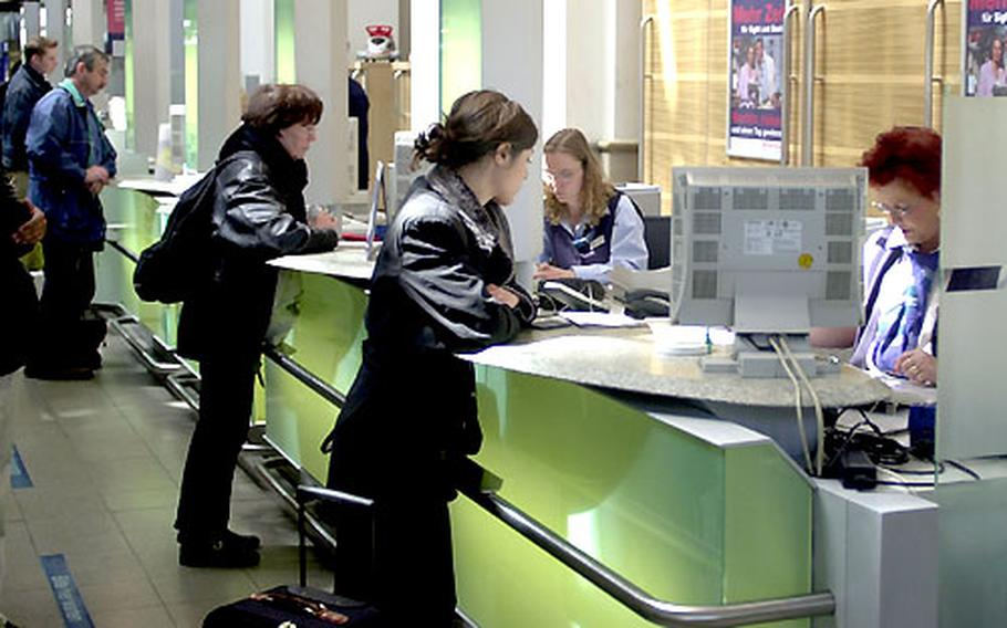 Travelers buy international train tickets at the station in Frankfurt, Germany. Eurail tickets are also available at the international counters.