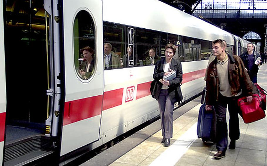 Travelers board a train at the station in Frankfurt, Germany.