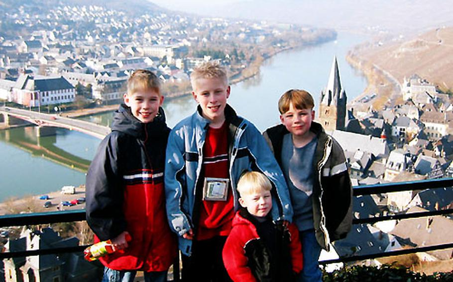 In planning family trips, the Moise family of Berglangenbach, Germany, makes sure there is something for everyone to enjoy. Posing for a photo overlooking Bernkastel-Kues on the Moselle River are the Moise sons, from left, Kyler, 9, Garrett, 11, Rohan, 4, and Bailey, 7.