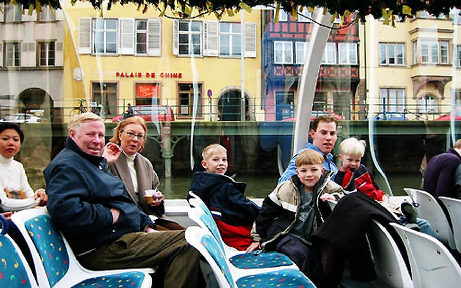 Three of the Moise kids and relatives take a boat tour of Strasbourg, France. Enjoying the tour, from left, are Richard Moise and Helen Moise and their grandchildren Kyler, 9, Bailey, 7, and Rohan 4, along with the boys' uncle Jared Moise.
