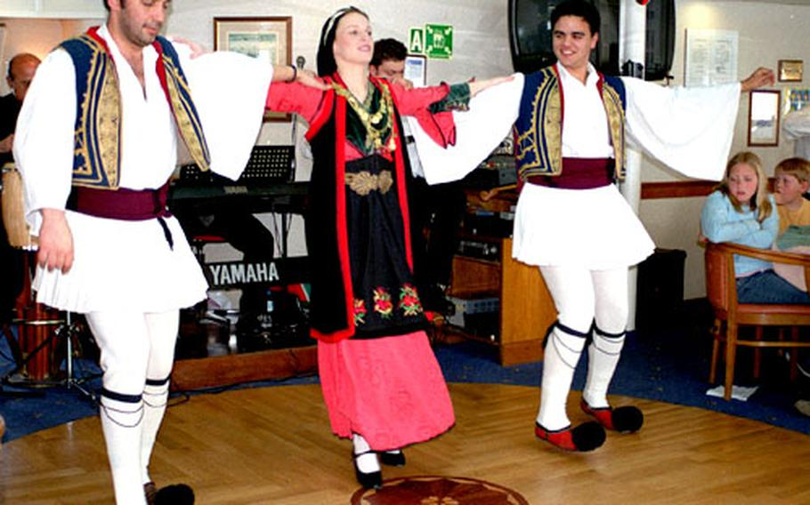 Traditional Greek dancing enlivens some day cruises to Aegina, Poros and Hydra.