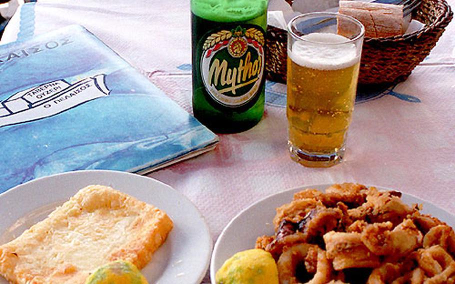 A wonderful Greek meal consists of fried calamari, fried feta cheese, and a smooth Greek beer like Mythos.