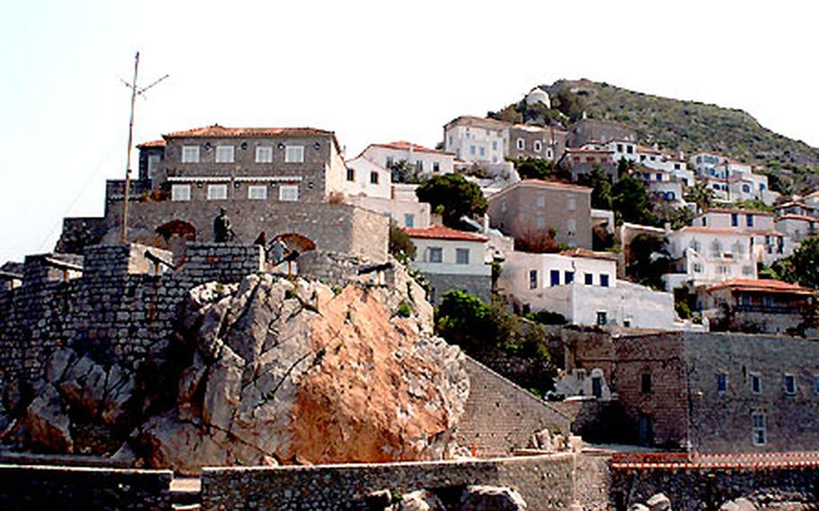 Coming into Hydra's port, an old cannon tower guards the island.