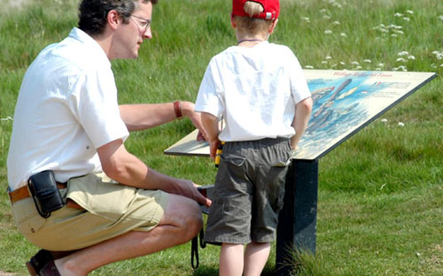 A father and son learn about the Battle of Hastings during a visit to the battlefield in Battle, England.