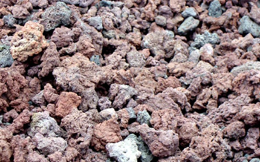 Lava rocks form most of the hiking trial on Mount Fuji.