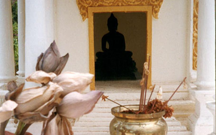 The Royal Palace grounds are filled with small monuments to Buddha.