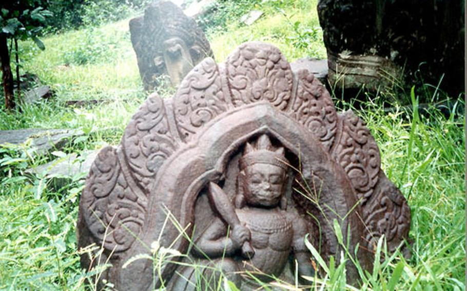 Many stone carvings at Angkor temples are missing or broken, the result of exposure to nature and looters seeking saleable artifacts.