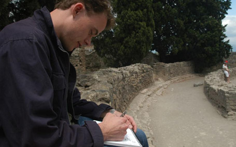 The ruins are a wonderland for photographers and artists. Many visitors, like this architect student from Yale, are content to sit and sketch the city.