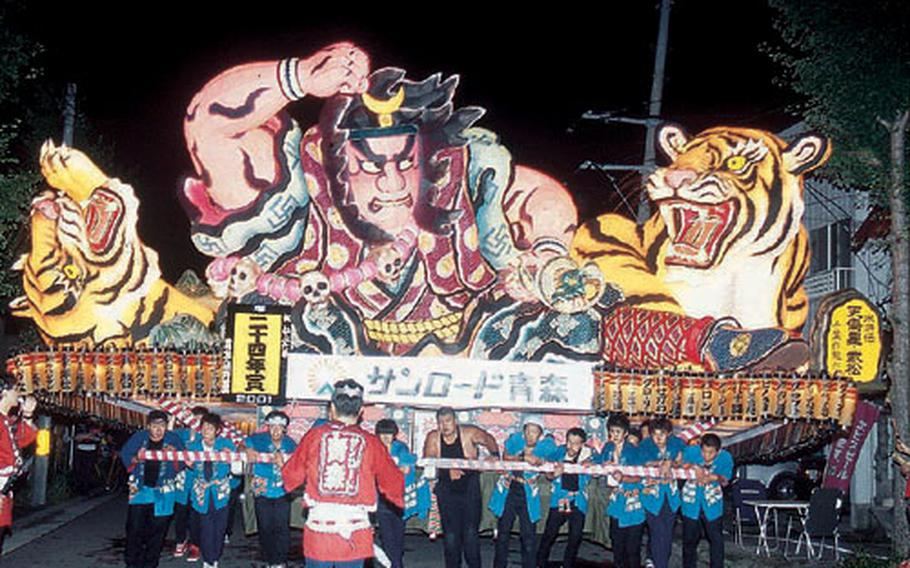 An ingeniously-made Nebuta float is carried through the streets. Giant figures on Nebuta floats are modeled from heroes of the past.