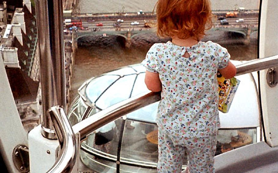 A toddler watches another capsule as it rises into view. The Eye moves so slowly and smoothly that children — and those with motion sickness — don't seem to be bothered by it.